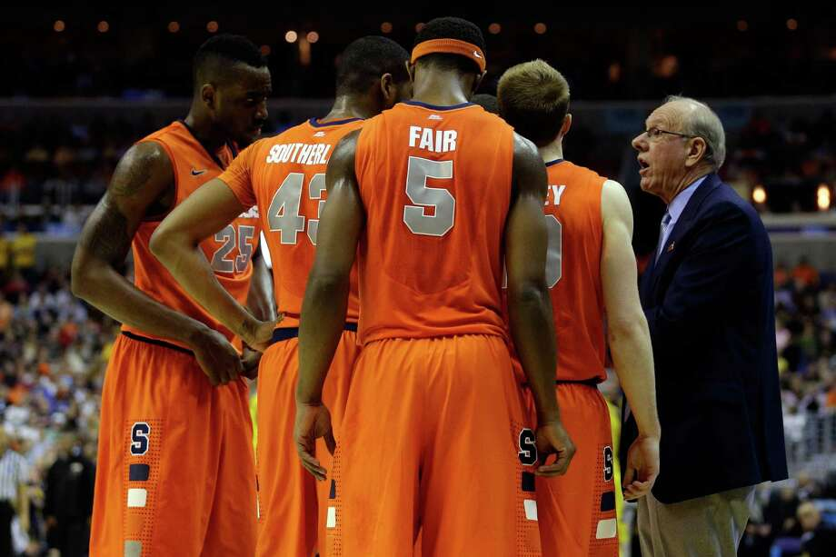 WASHINGTON, DC - MARCH 30:  Head coach Jim Boeheim of the Syracuse Orange talks to his team against the Marquette Golden Eagles during the East Regional Round Final of the 2013 NCAA Men's Basketball Tournament at Verizon Center on March 30, 2013 in Washington, DC.  (Photo by Rob Carr/Getty Images) Photo: Rob Carr