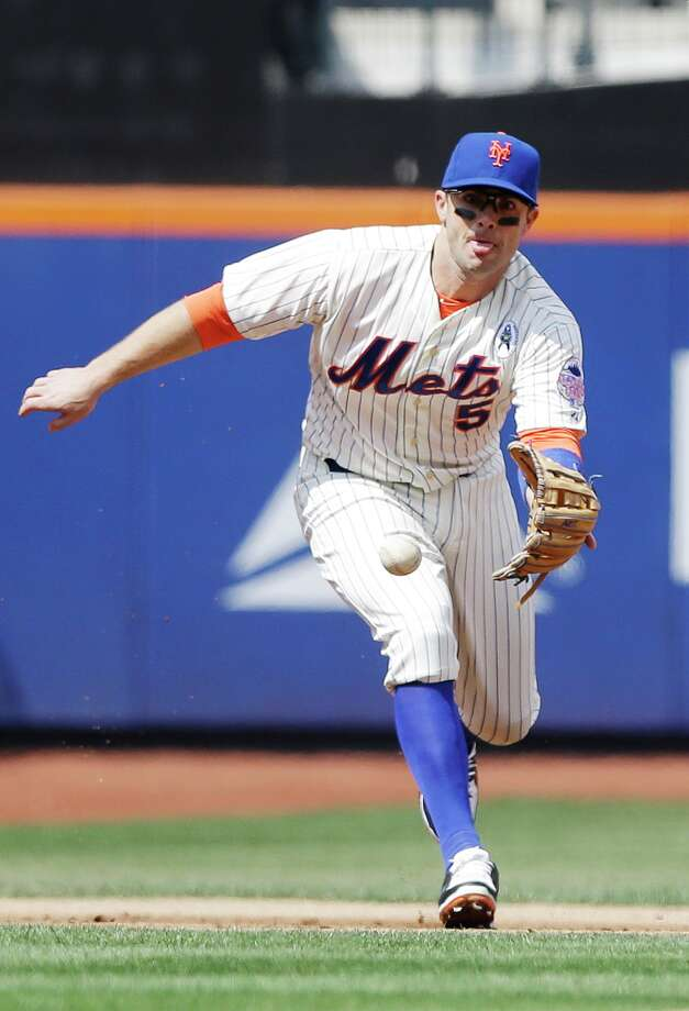 New York Mets third baseman David Wright chases a ground ball hit by San Diego Padres' Jedd Gyorko during the first inning of an opening day baseball game Monday, April 1, 2013, in New York. Gyorko was out on the play. (AP Photo/Frank Franklin II) Photo: Frank Franklin II