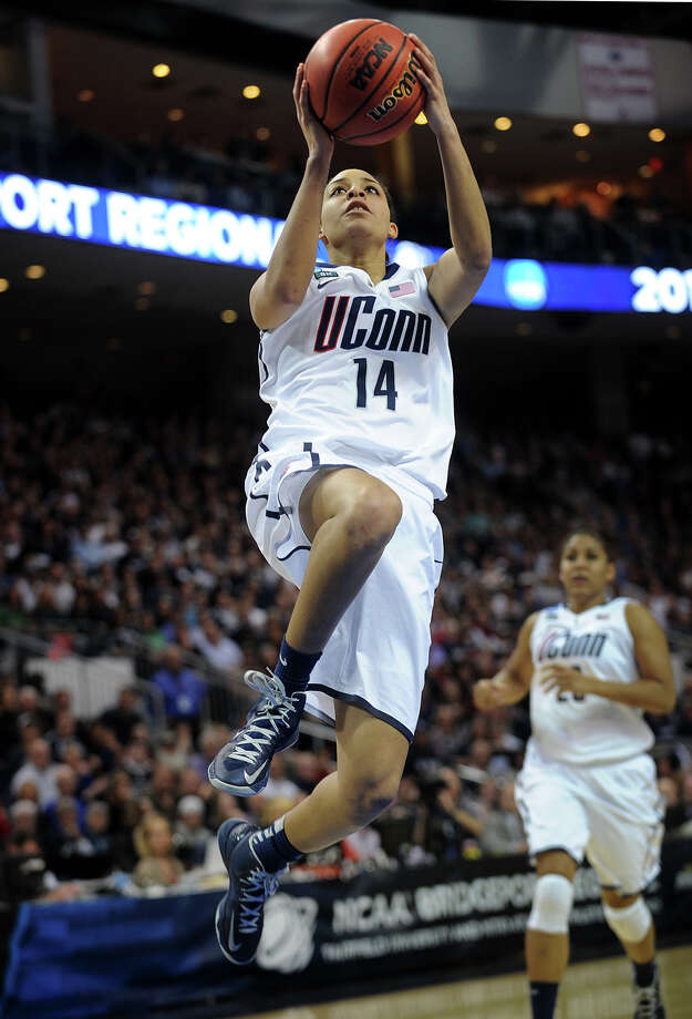 UConn's Bria Hartley drives to the basket during the Huskies' matchup with Kentucky in the elite eight round of the NCAA Women's Basketball Tournament at the Webster Bank Arena in Bridgeport, Conn. on Monday, April 1, 2013. Photo: Brian A. Pounds / Connecticut Post