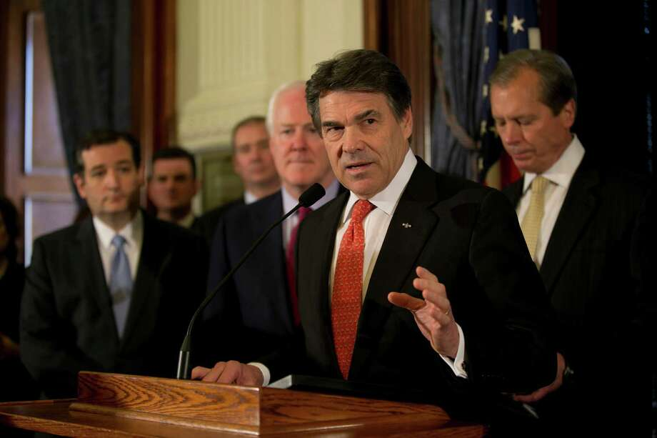 Gov. Rick Perry holds an Austin news conference Monday - along with U.S. Sens. Ted Cruz and John Cornyn, left and 4th from left, and Lt. Gov. David Dewhurst, right - to announce they believe expanding Medicaid is the wrong move. Photo: Deborah Cannon, MBO / Austin American-Statesman