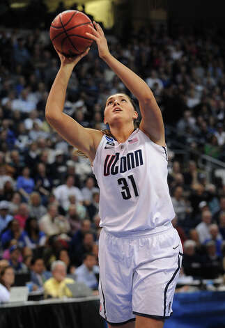 UConn's Stefanie Dolson drives to the basket during their 83-53 victory over Kentucky in the elite eight round of the NCAA Women's Basketball Tournament at the Webster Bank Arena in Bridgeport, Conn. on Monday, April 1, 2013. Photo: Brian A. Pounds / Connecticut Post
