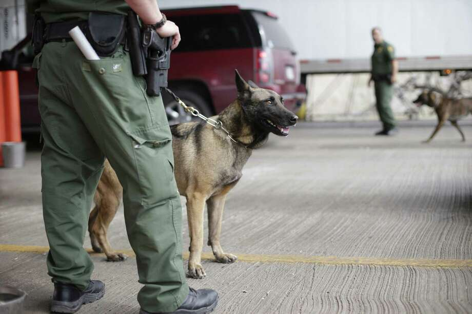 Border Patrol agents and a security dog work in Falfurrias in February. Agents had been facing 14 days of furlough in the rest of the fiscal year. Photo: Associated Press File Photo