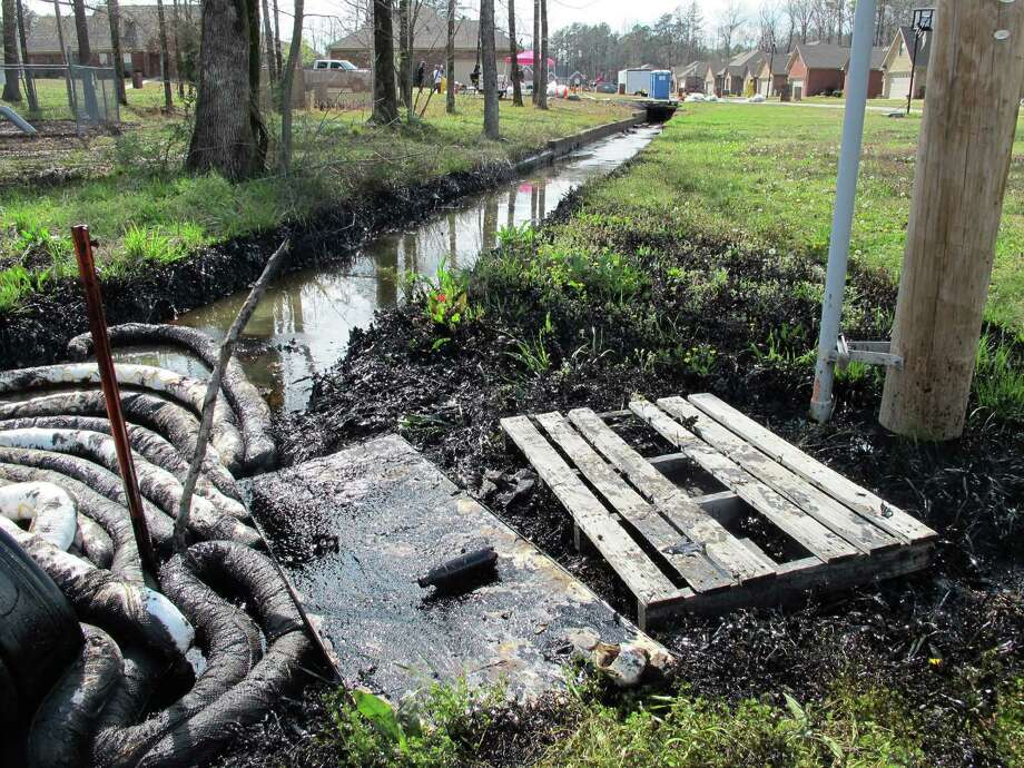 Exxon Mobil's Pegasus pipeline ruptured near a drainage ditch in Mayflower, Ark., leaking oil into a stream leading to Lake Conway. Residents near the spill were evacuated. Photo: Alan English / Log Cabin Democrat
