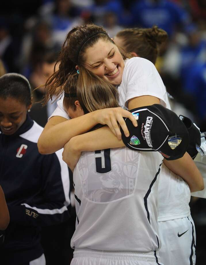 UConn's Stefanie Dolson, facing, hugs teammate Caroline Doty following their 83-53 victory over Kentucky in the elite eight round of the NCAA Women's Basketball Tournament at the Webster Bank Arena in Bridgeport, Conn. on Monday, April 1, 2013.