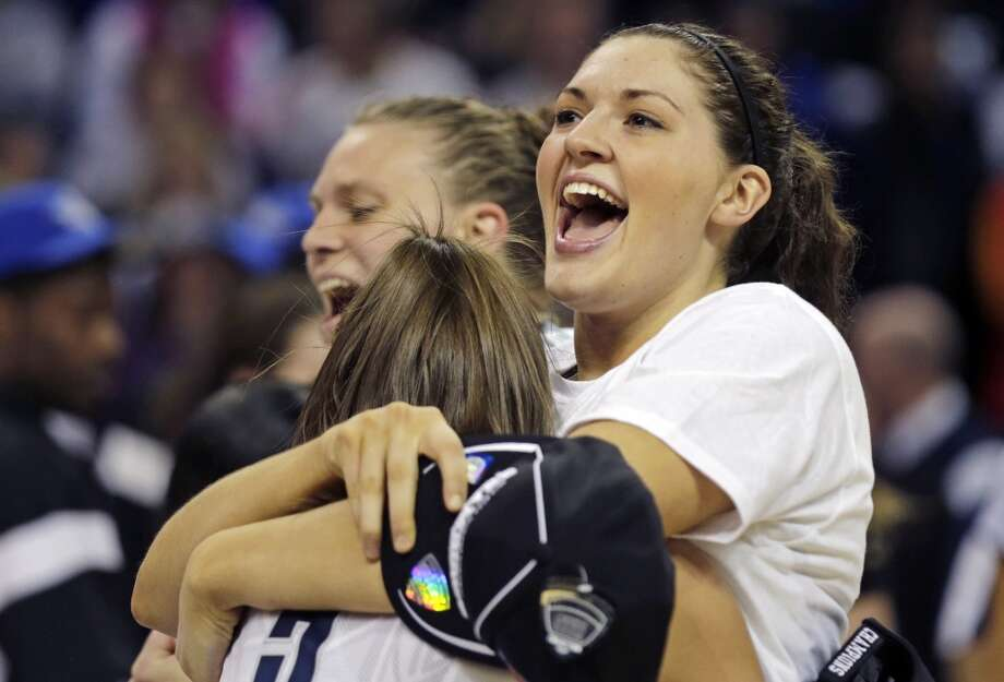 Connecticut forward Breanna Stewart smiles as she embraces teammate Caroline Doty after beating Kentucky in the women's NCAA regional final basketball game in Bridgeport, Conn., Monday, April 1, 2013. Connecticut won 83-53 and advances to the Final Four. (AP Photo/Charles Krupa)