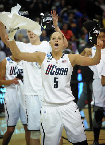 UConn's Caroline Doty celebrates their 83-53 victory over Kentucky in the elite eight round of the NCAA Women's Basketball Tournament at the Webster Bank Arena in Bridgeport, Conn. on Monday, April 1, 2013. Photo: Brian A. Pounds / Connecticut Post