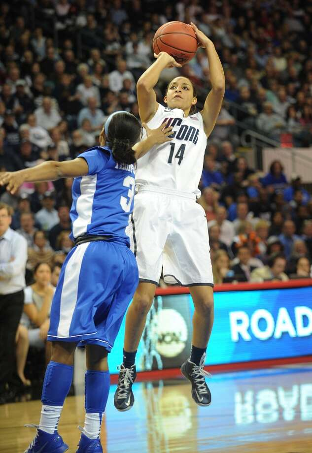 UConn's Bria Hartley shoots a jumper over Kentucky's Janee Thompson during their 83-53 victory in the elite eight round of the NCAA Women's Basketball Tournament at the Webster Bank Arena in Bridgeport, Conn. on Monday, April 1, 2013.