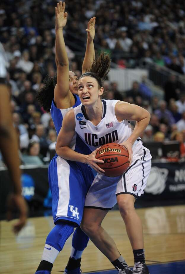 UConn's Kelly Faris drives to the basket past Kentucky defender Jennifer O'Neill during their 83-53 victory in the elite eight round of the NCAA Women's Basketball Tournament at the Webster Bank Arena in Bridgeport, Conn. on Monday, April 1, 2013.