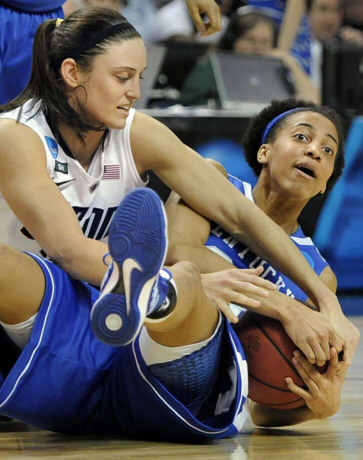 Connecticut's Kelly Faris, left, pressures Kentucky's Kastine Evans, right, during the second half of a  women's regional final game in the NCAA college basketball tournament in Bridgeport, Conn., Monday, April 1, 2013. Connecticut won 83-53.(AP Photo/Jessica Hill)