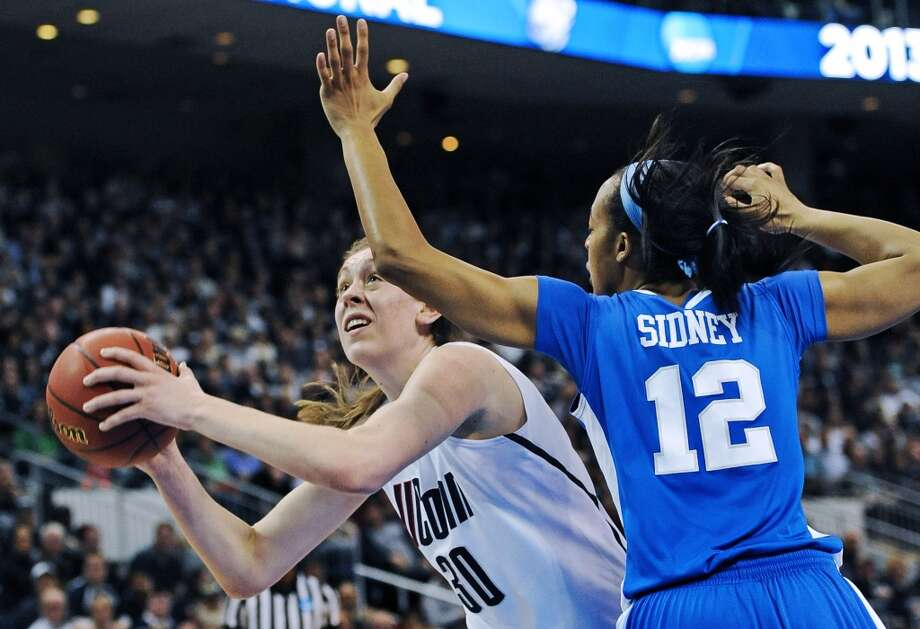 Connecticut forward Breanna Stewart (30) drives to the basket against Kentucky forward Jelleah Sidney (12) in the first half of a women's NCAA regional final basketball game in Bridgeport, Conn., Monday, April 1, 2013. Stewart scored 21 in the team's 83-53 victory. (AP Photo/Jessica Hill)