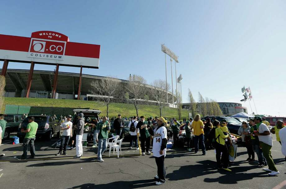 OAKLAND, CA - APRIL 01:  Fans tailgate before the start of the Oakland Athletics game against the Seattle Mariners on Opening Day at O.co Coliseum on April 1, 2013 in Oakland, California. Photo: Ezra Shaw, Getty Images / 2013 Getty Images