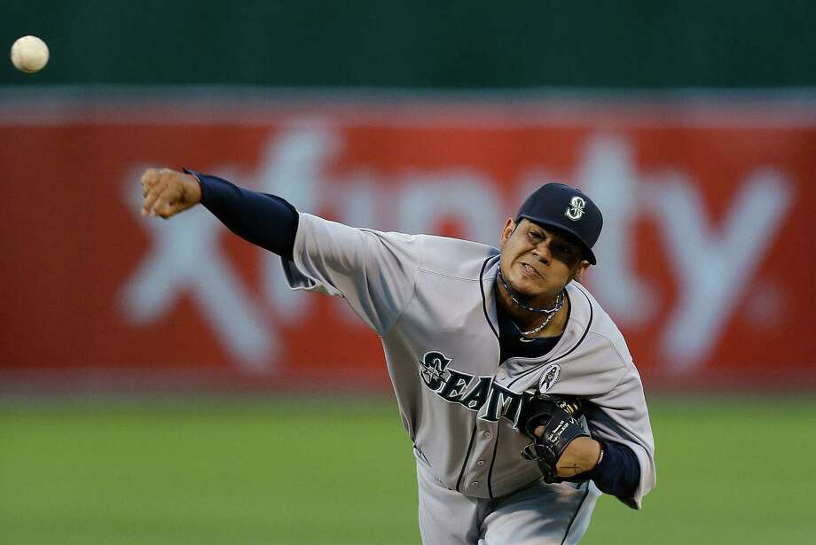 Seattle Mariners' Felix Hernandez works against the Oakland Athletics in the first inning of a baseball game Monday, April 1, 2013, in Oakland, Calif. Photo: AP