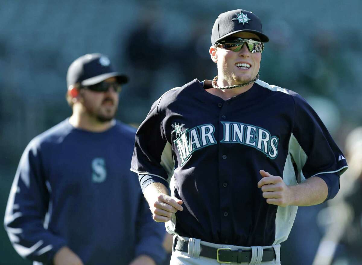Seattle Mariners' Carter Capps, right, runs during batting practice before the baseball game against the Oakland Athletics Monday, April 1, 2013, in Oakland, Calif.