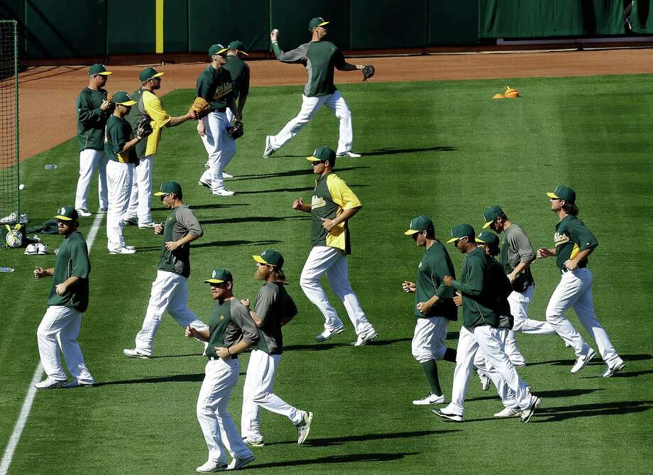 The Oakland Athletics warm up during batting practice before their baseball game against the Seattle Mariners Monday, April 1, 2013, in Oakland, Calif. Photo: AP