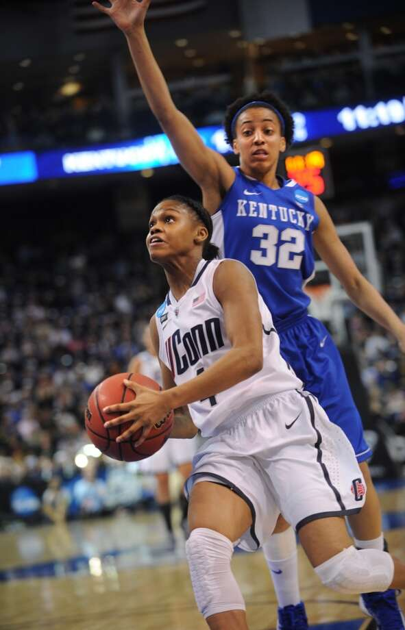 UConn's Moriah Jefferson drives to the basket ahead of Kentucky defender Kastine Evans during  the Huskies' 83-53 victory in the elite eight round of the NCAA Women's Basketball Tournament at the Webster Bank Arena in Bridgeport, Conn. on Monday, April 1, 2013.