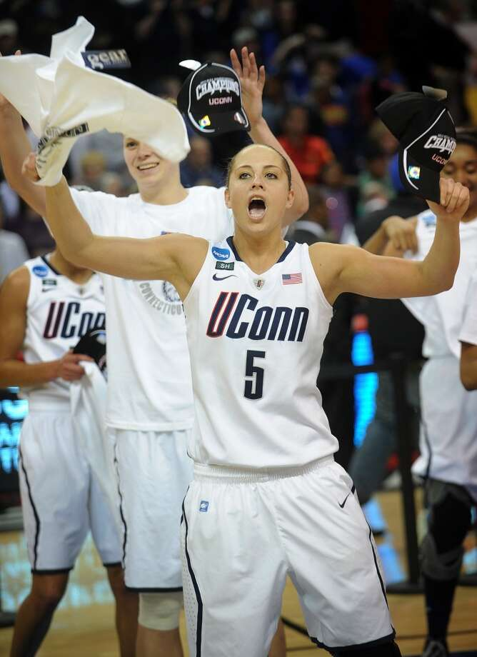 UConn's Caroline Doty celebrates their 83-53 victory over Kentucky in the elite eight round of the NCAA Women's Basketball Tournament at the Webster Bank Arena in Bridgeport, Conn. on Monday, April 1, 2013.