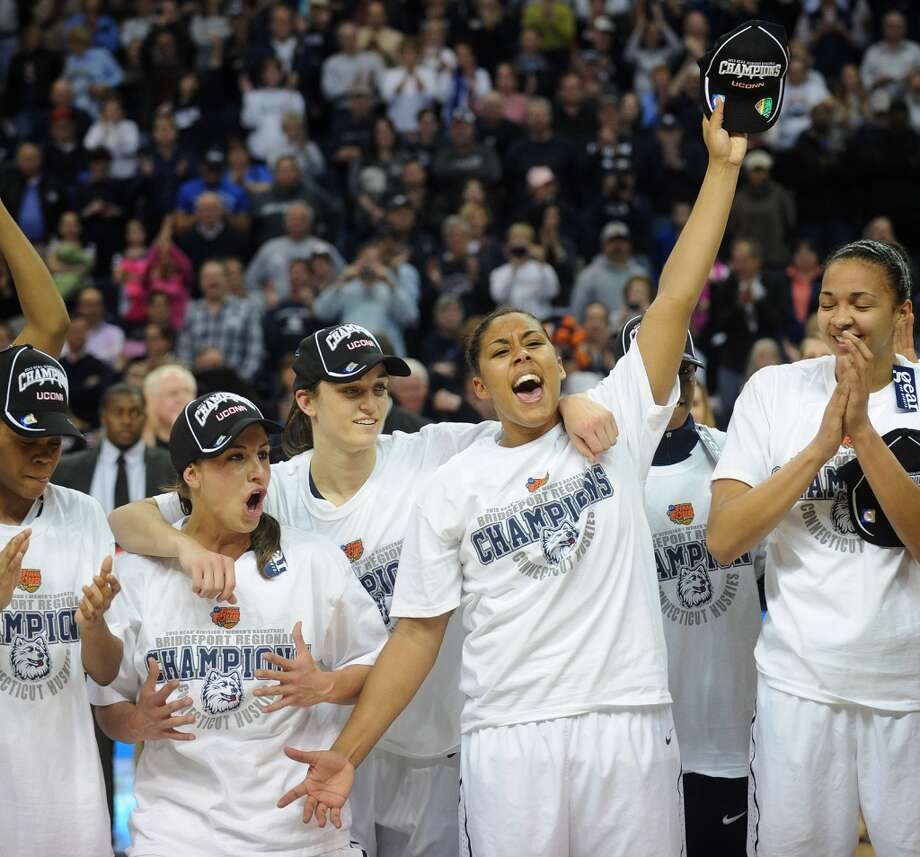 UConn's teammates celebrate their 83-53 victory over Kentucky in the elite eight round of the NCAA Women's Basketball Tournament at the Webster Bank Arena in Bridgeport, Conn. on Monday, April 1, 2013.