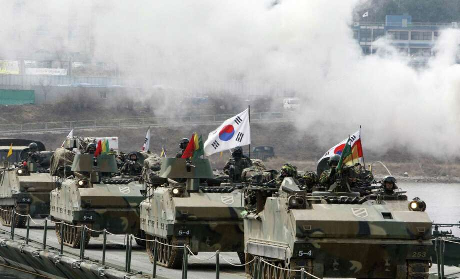 South Korean army armored vehicles cross a pontoon bridge during an exercise against possible attacks by North Korea near the demilitarized zone in Hwacheon, South Korea. Photo: Lee Hae-ryong / Associated Press