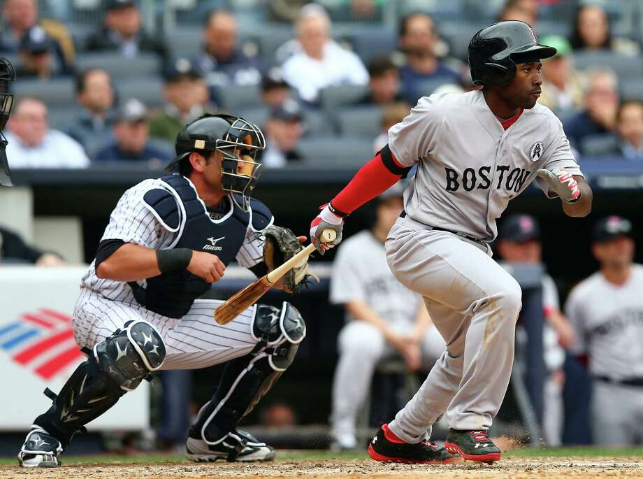 Red Sox rookie Jackie Bradley Jr. follows through on an RBI groundout in Boston's win at New York. Photo: Elsa / Getty Images