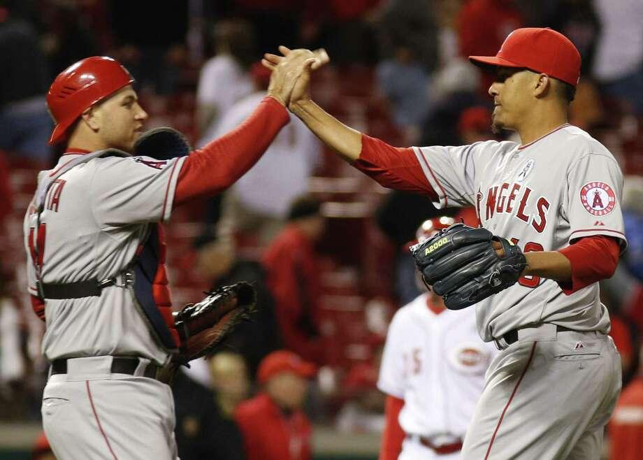 Angels catcher Chris Iannetta congratulates reliever Ernesto Frieri after locking down L.A.'s victory. Photo: David Kohl / Associated Press