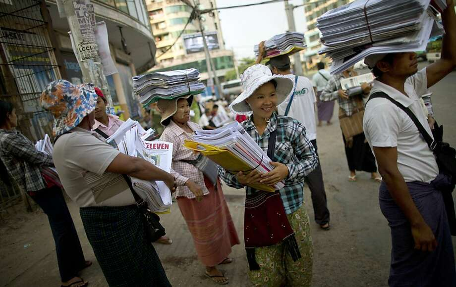 Newspaper sellers wait for a bus after receiving newspapers from a wholesale dispatcher in Yangon, Myanmar, Monday, April 1, 2013. For most people in Myanmar, it will be a novelty when privately run daily newspapers hit the streets on Monday. Many weren't even born when the late dictator Ne Win imposed a state monopoly on the daily press in the 1960s. Photo: Gemunu Amarasinghe, Associated Press