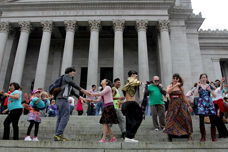People dance on the steps of the Capitol in Olympia, Wash., Monday, April 1, 2013 to protest a decades-old state tax on dance venues. Washington state has had the tax, which targets venues that provide an opportunity to dance, since the 1960s. A measure to repeal it has cleared a committee and is awaiting a floor vote in the Senate. Photo: Manuel Valdes, Associated Press