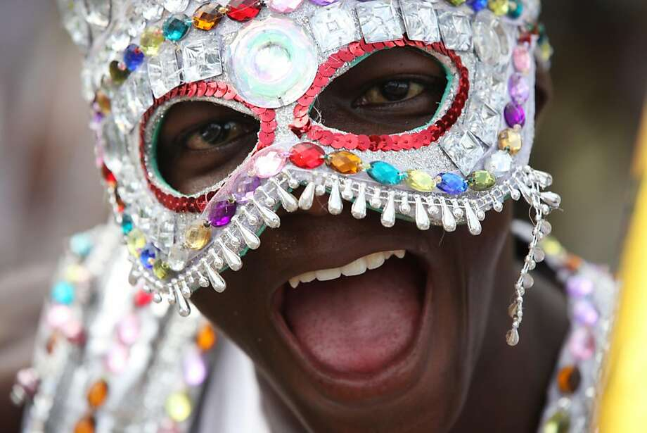 A performer walk through the street during Lagos Carnival in Lagos, Nigeria,  Monday, April 1, 2013. Performers filled the streets of Lagos' islands Monday as part of the Lagos Carnival, a major festival in Nigeria's largest city during Easter weekend.  Photo: Sunday Alamba, Associated Press