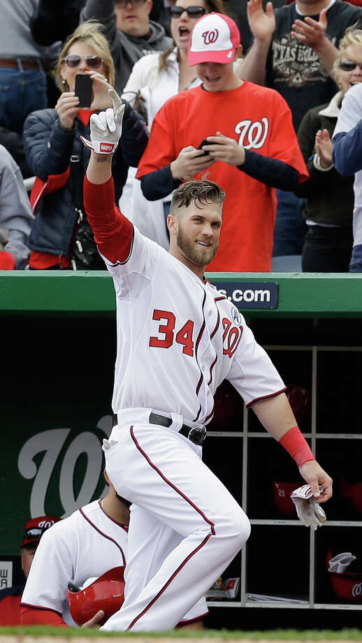 WASHINGTON, DC - APRIL 01:  Bryce Harper #34 of the Washington Nationals waves to the crowd after hitting a solo home run against the Miami Marlins during the fourth inning of their opening day game at Nationals Park on April 1, 2013 in Washington, DC.  (Photo by Rob Carr/Getty Images) Photo: Rob Carr