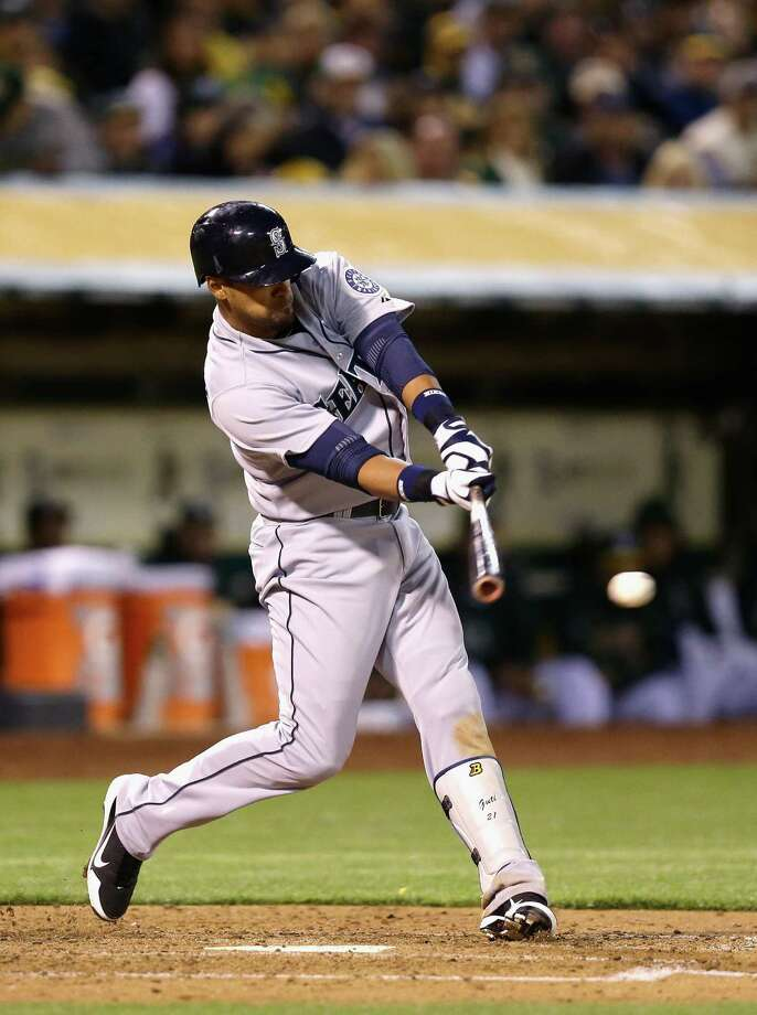 OAKLAND, CA - APRIL 01: Franklin Gutierrez #21 of the Seattle Mariners hits a single that scored two runs in the fifth inning of their game against the Oakland Athletics during Opening Day at O.co Coliseum on April 1, 2013 in Oakland, California. Photo: Ezra Shaw, Getty Images / 2013 Getty Images