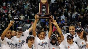 UConn player raise the Regional Championship trophy following their 83-53 victory over Kentucky in the elite eight round of the NCAA Women's Basketball Tournament at the Webster Bank Arena in Bridgeport, Conn. on Monday, April 1, 2013.