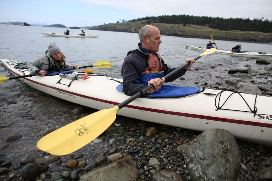 U.S. Rep. Rick Larsen prepares to depart on a kayak during a tour of Iceberg Point on Lopez Island as the San Juan Islands National Monument is celebrated on Monday, April 1, 2013. (Joshua Trujillo, seattlepi.com)