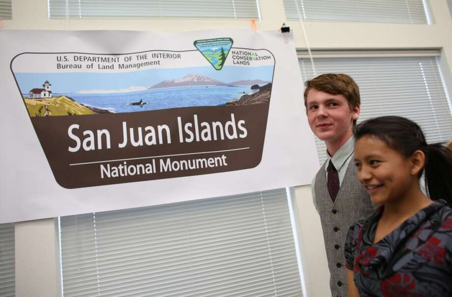 Graham Crawbuck, 16, and Reyna Ellis, 17, of Friday Harbor, attend an event with Secretary of the Interior Ken Salazar, Rep. Rick Larsen, Senator Maria Cantwell, Rep. Suzan DelBene and other local and national officials as the newly-designated San Juan Islands National Monument is celebrated on Monday, April 1, 2013 at the senior center in Anacortes. (Joshua Trujillo, seattlepi.com)