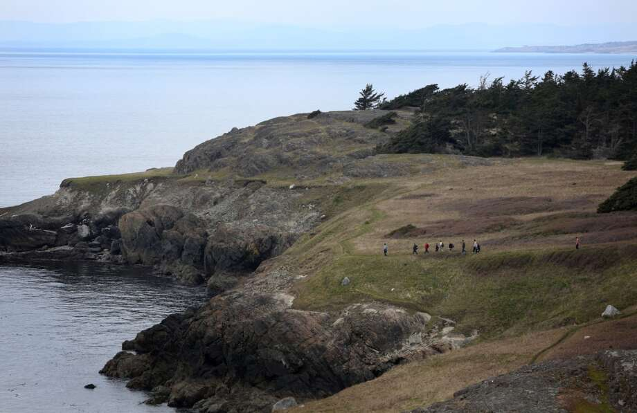Hikers walk along Iceberg Point during a tour on Lopez Island as the San Juan Islands National Monument is celebrated on Monday, April 1, 2013. (Joshua Trujillo, seattlepi.com)