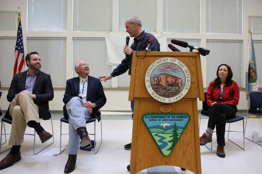 Rep. Rick Larsen addresses Secretary of the Interior Ken Salazar during an event attended by Senator Maria Cantwell, right, BLM Deputy Director Neil Kornze, left, and other local and national officials as the newly-designated San Juan Islands National Monument is celebrated on Monday, April 1, 2013 at the senior center in Anacortes. (Joshua Trujillo, seattlepi.com)