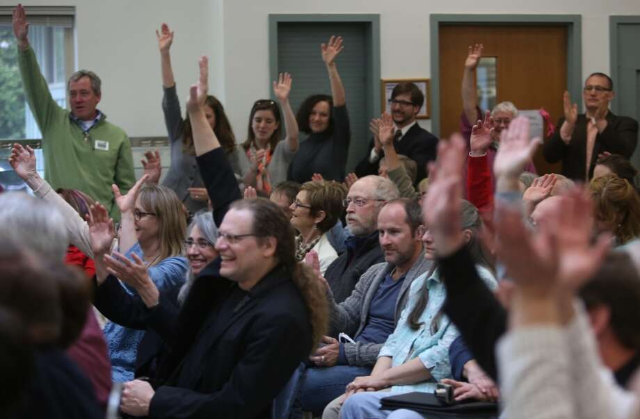 Audience members raise their hands in support as Secretary of the Interior Ken Salazar asks if they supported the newly-designated San Juan Islands National Monument during a celebration on Monday, April 1, 2013 at the senior center in Anacortes. (Joshua Trujillo, seattlepi.com)