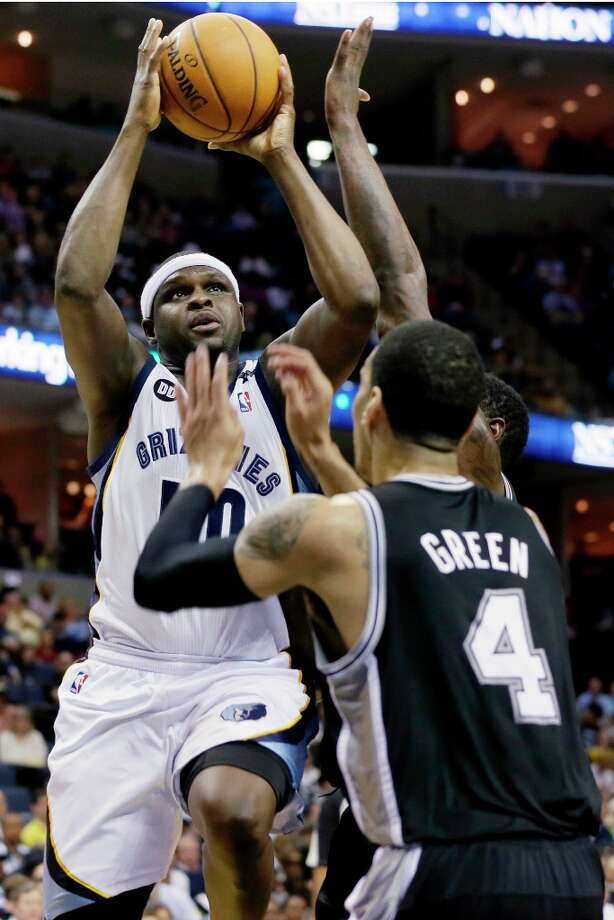 Memphis Grizzlies' Zach Randolph (left) goes to the basket over the Spurs' Danny Green (4) during the first half in Memphis, Tenn., Monday, April 1, 2013. Photo: Danny Johnston, Associated Press / AP