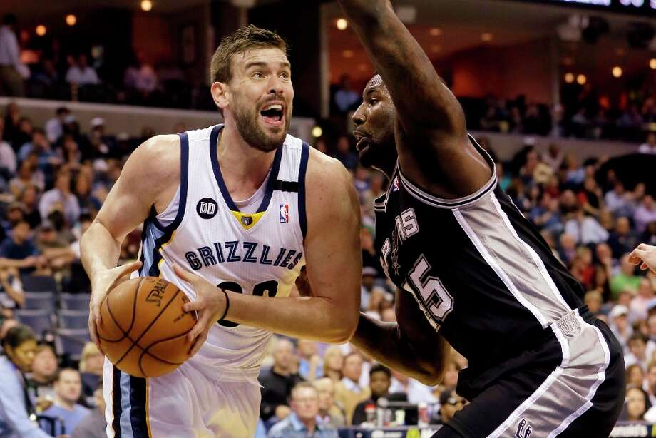 Memphis Grizzlies' Marc Gasol (33), of Spain, takes the ball around the Spurs' DeJuan Blair during the first half in Memphis, Tenn., Monday, April 1, 2013. Photo: Danny Johnston, Associated Press / AP