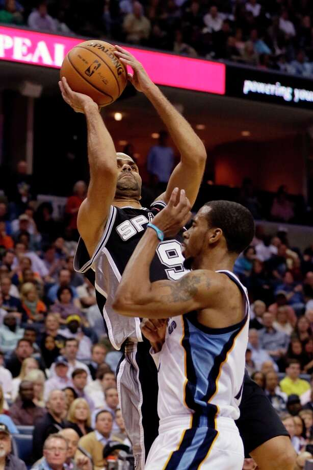 The Spurs' Tony Parker (9) shoots over Memphis Grizzlies' Mike Conley during the second half in Memphis, Tenn., Monday, April 1, 2013. Parker scored 25 points in the Spurs' 92-90 loss to the Grizzlies. Photo: Danny Johnston, Associated Press / AP