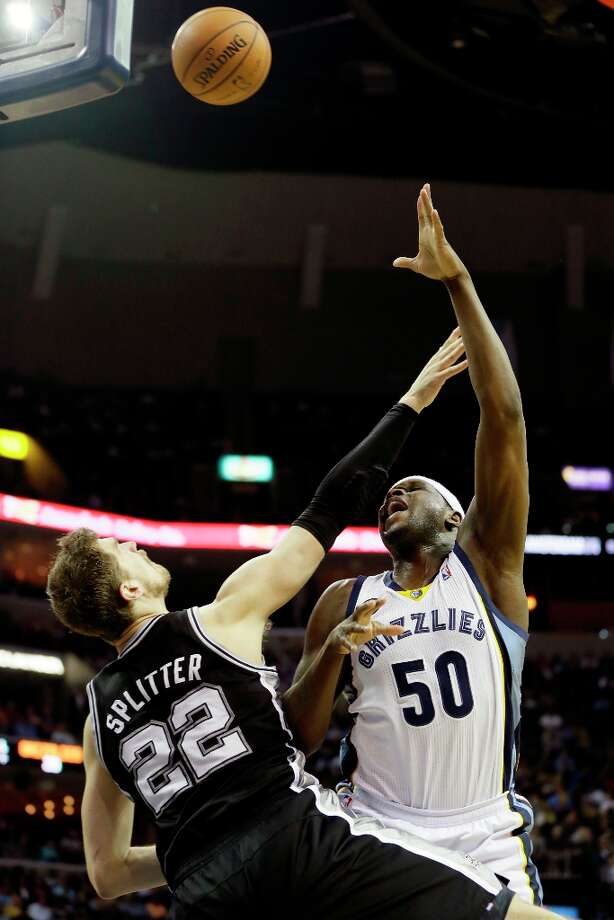 The Spurs' Tiago Splitter (22) defends against Memphis Grizzlies' Zach Randolph (50) during the first half in Memphis, Tenn., Monday, April 1, 2013. Photo: Danny Johnston, Associated Press / AP
