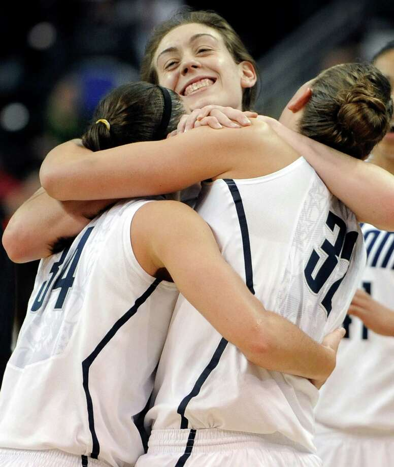 UConn's Breanna Stewart, center, embraces teammates Kelly Faris, left, and Heather Buck, as well as a Final Four berth. Stewart had 21 points Monday. Photo: Jessica Hill, FRE / FR125654 AP