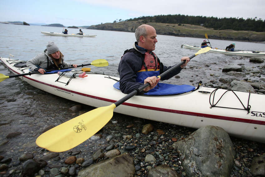 U.S. Rep. Rick Larsen prepares to depart on a kayak during a tour of Iceberg Point on Lopez Island as the San Juan Islands National Monument is celebrated on Monday, April 1, 2013.
