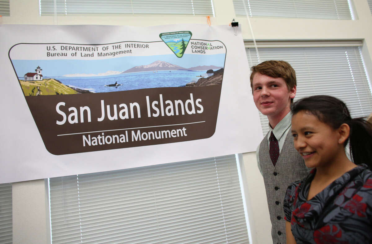 Graham Crawbuck, 16, and Reyna Ellis, 17, of Friday Harbor, attend an event with Secretary of the Interior Ken Salazar, Rep. Rick Larsen, Senator Maria Cantwell, Rep. Suzan DelBene and other local and national officials as the newly-designated San Juan Islands National Monument is celebrated on Monday, April 1, 2013 at the senior center in Anacortes.