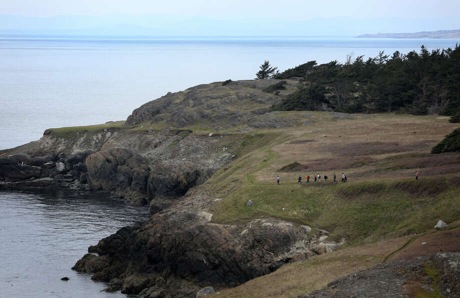 Hikers walk along Iceberg Point during a tour on Lopez Island as the San Juan Islands National Monument is celebrated on Monday, April 1, 2013. Photo: JOSHUA TRUJILLO / SEATTLEPI.COM