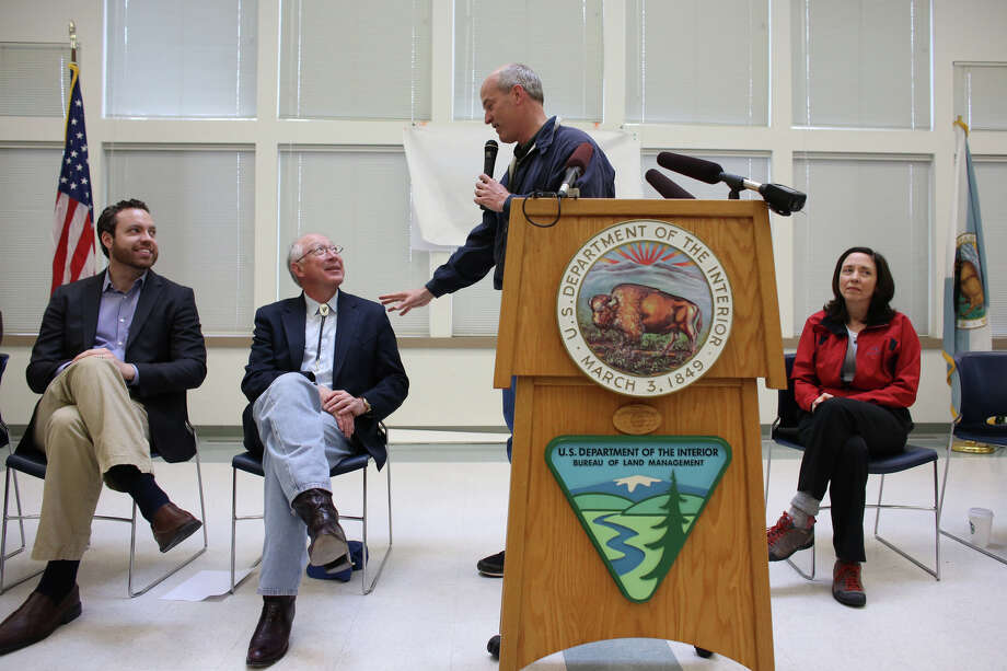 Rep. Rick Larsen addresses Secretary of the Interior Ken Salazar during an event attended by Senator Maria Cantwell, right, BLM Deputy Director Neil Kornze, left, and other local and national officials as the newly-designated San Juan Islands National Monument is celebrated on Monday, April 1, 2013 at the senior center in Anacortes. Photo: JOSHUA TRUJILLO / SEATTLEPI.COM