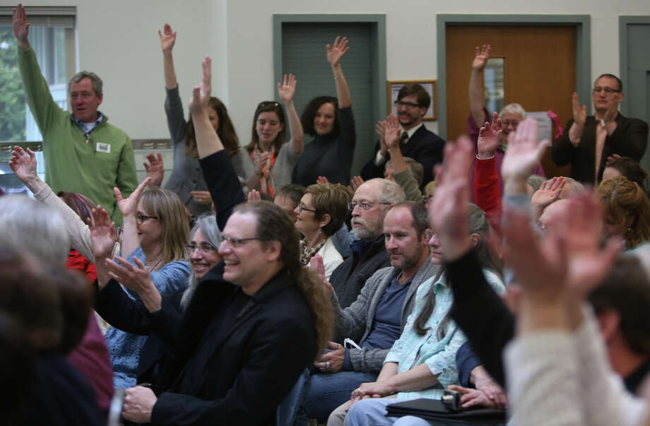 Audience members raise their hands in support as Secretary of the Interior Ken Salazar asks if they supported the newly-designated San Juan Islands National Monument during a celebration on Monday, April 1, 2013 at the senior center in Anacortes. Photo: JOSHUA TRUJILLO / SEATTLEPI.COM
