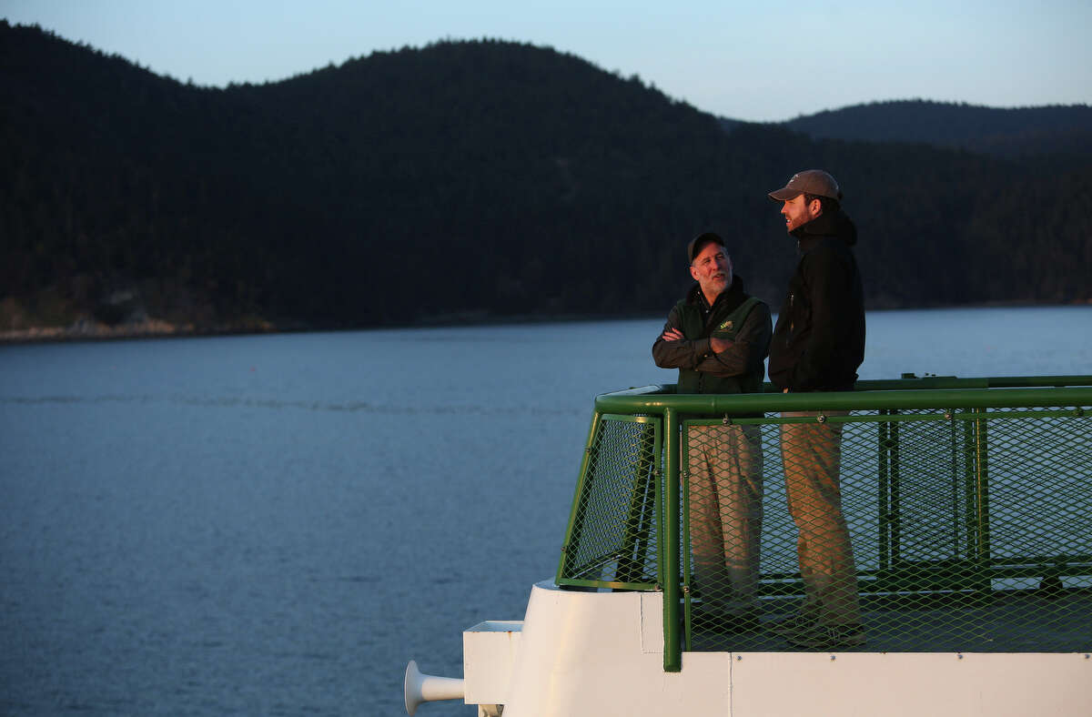 Jerry Perez, BLM state director for Washington and Oregon, and BLM Deputy Director Neil Kornze take in the scenery aboard a Washington State ferry after a tour of Lopez Island as the San Juan Islands National Monument is celebrated on Monday, April 1, 2013.