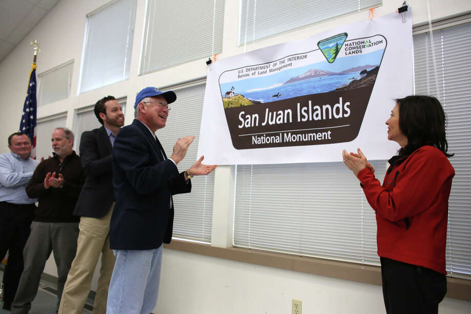 Secretary of the Interior Ken Salazar, left, and Senator Maria Cantwell unveil a sign for the newly-designated San Juan Islands National Monument is celebrated on Monday, April 1, 2013 at the senior center in Anacortes. Photo: JOSHUA TRUJILLO / SEATTLEPI.COM