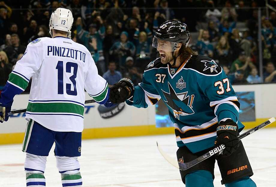 Sharks center Adam Burish celebrates a goal by teammate Andrew Desjardins (not pictured) against Vancouver in the second period. Photo: Thearon W. Henderson, Getty Images