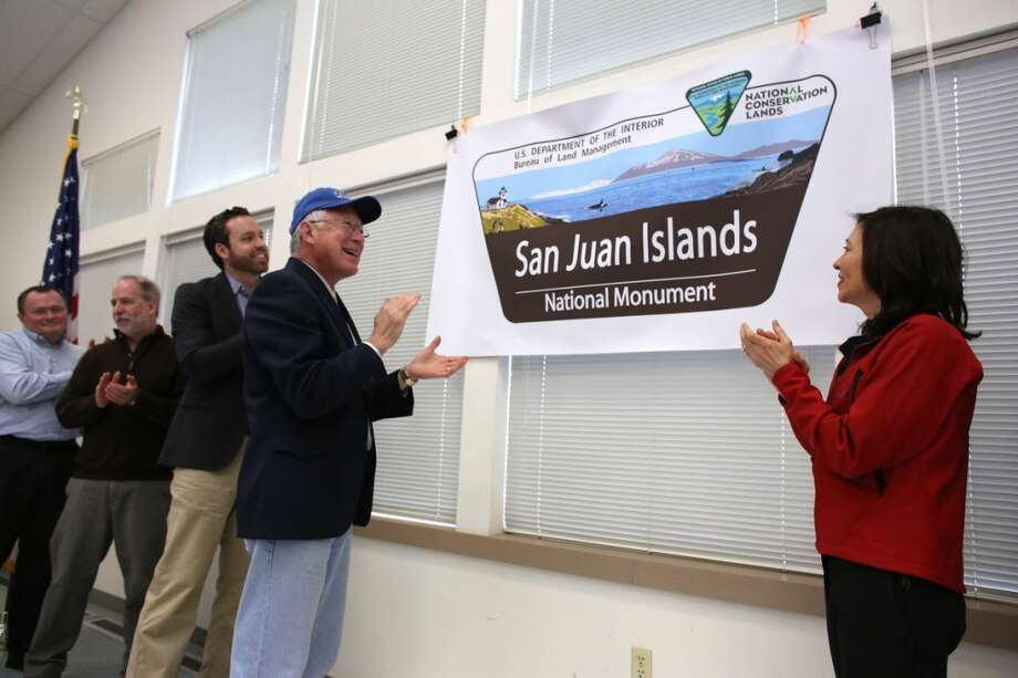 Secretary of the Interior Ken Salazar, left, and Senator Maria Cantwell unveil a sign for the newly-designated San Juan Islands National Monument is celebrated on Monday, April 1, 2013 at the senior center in Anacortes. (Joshua Trujillo, seattlepi.com)