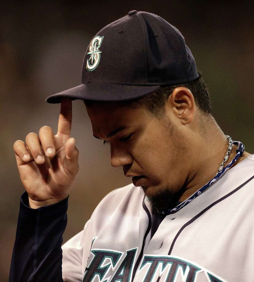 Seattle Mariners' Felix Hernandez leaves the baseball game against the Oakland Athletics in the eighth inning Monday, April 1, 2013, in Oakland, Calif. Photo: AP